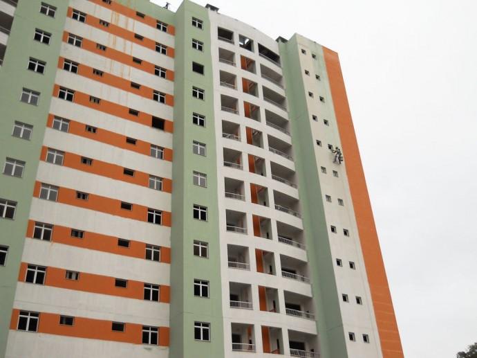 Execução da pintura da fachada